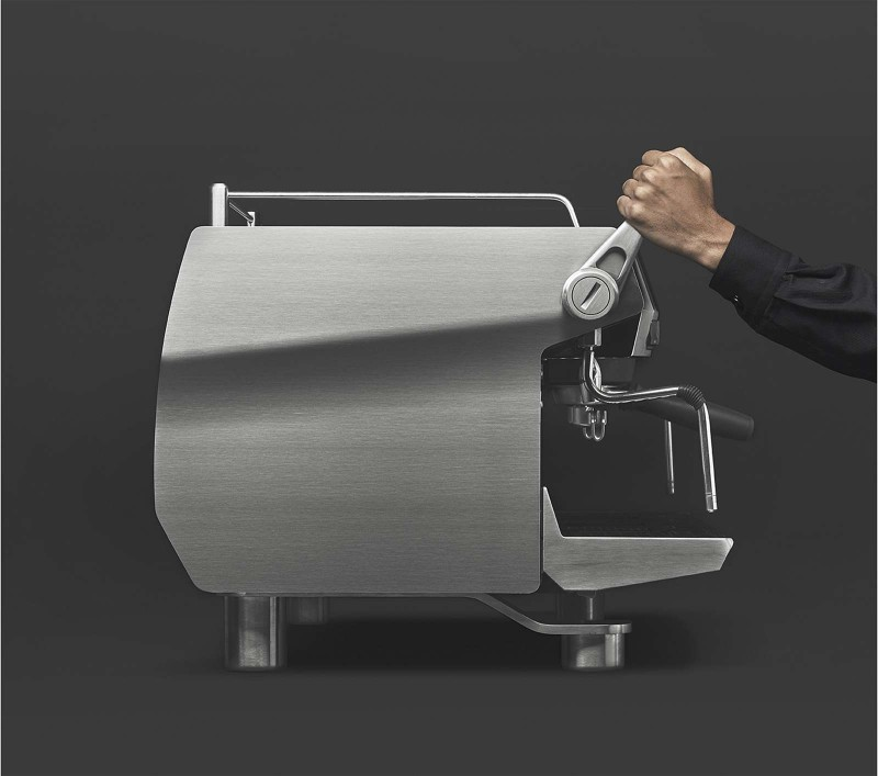 This image is a front-side view of the Rancilio Specialty RS1 2 group espresso machine in Stainless Steel, with adjustable drip tray for varied brew group height and lever for steam actuation.