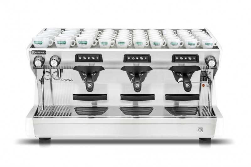 This image is a front view of the Rancilio Classe 5 USB espresso machine in Ice White, with 3 groups at traditional height with volumetric dosing.