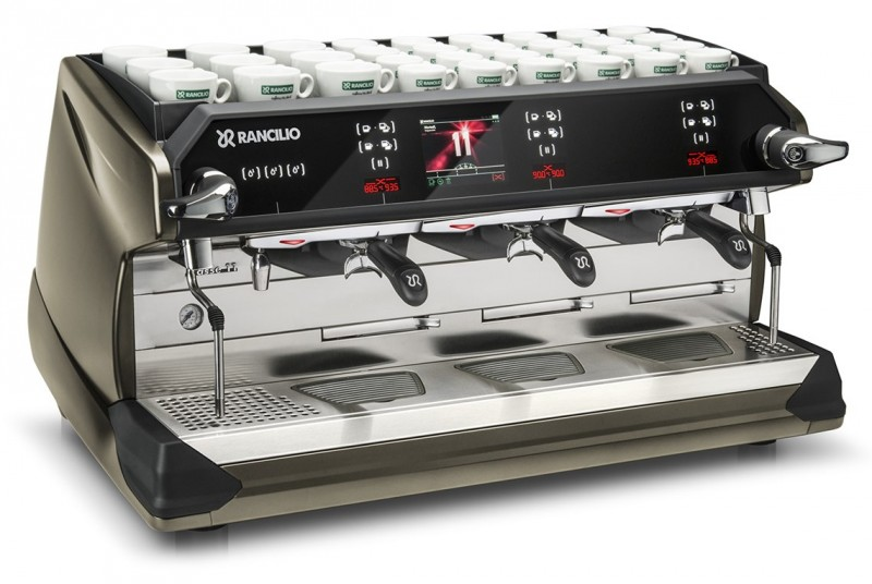 This image is a front-side view of the Rancilio Classe 11 Xcelsius tall in frozen bronze, 3 groups with a higher group area and volumetric dosing controls.