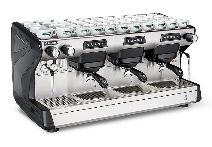 This image is a front-side view of the Rancilio Classe 5 USB espresso machine in Anthracite Black, with 3 groups at traditional height with volumetric dosing.