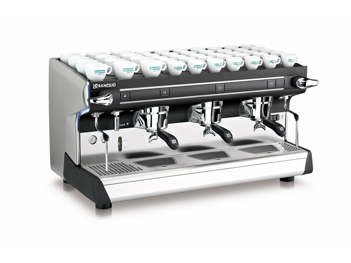 This image is a front-side view of the Rancilio Classe 9 S espresso machine in 3 groups at traditional height with semi-automatic dosing controls.