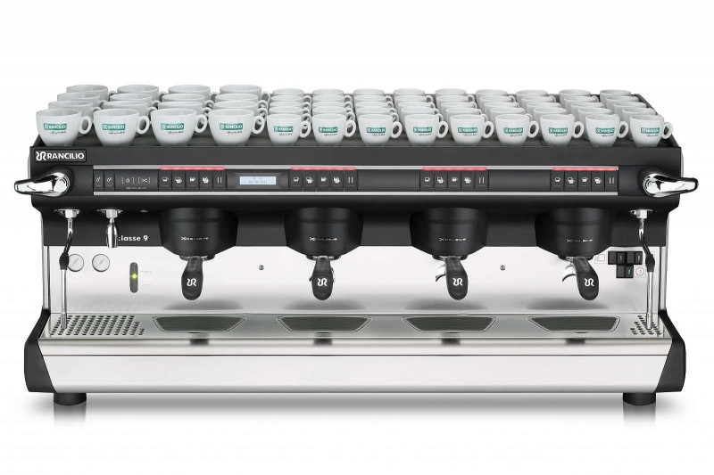 This image is a front view of the Rancilio Classe 9 Xcelsius, 4 groups at traditional height and volumetric dosing controls.