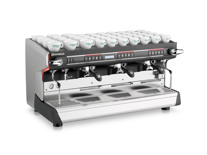 This image is a front-side view of the Rancilio Classe 9 Xcelsius tall, 3 groups with a taller group area and volumetric dosing controls.