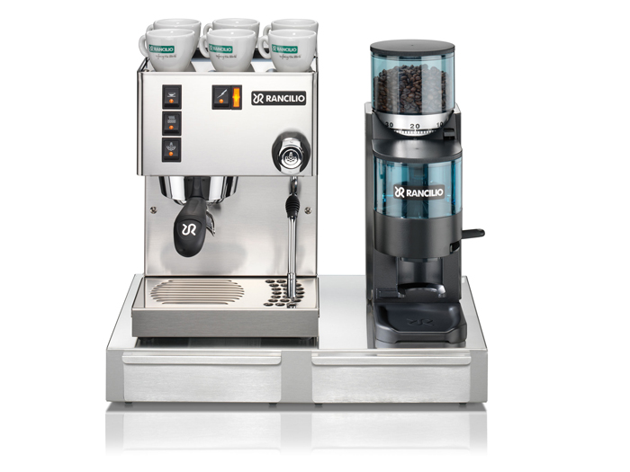 This image is a front view of the Rancilio Sylvia home espresso machine, 1 group at traditional height, semi-automatic dosing controls, next to the Rocky SS grinder.