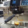 This image is a closeup view of the Rancilio Specialty RS1 espresso machine in Stainless Steel, with adjustable drip tray for varied brew group height and volumetric dosing controls.